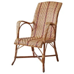Vintage Rattan Armchair with Orange Stripes and Woven Details, France, 1930s