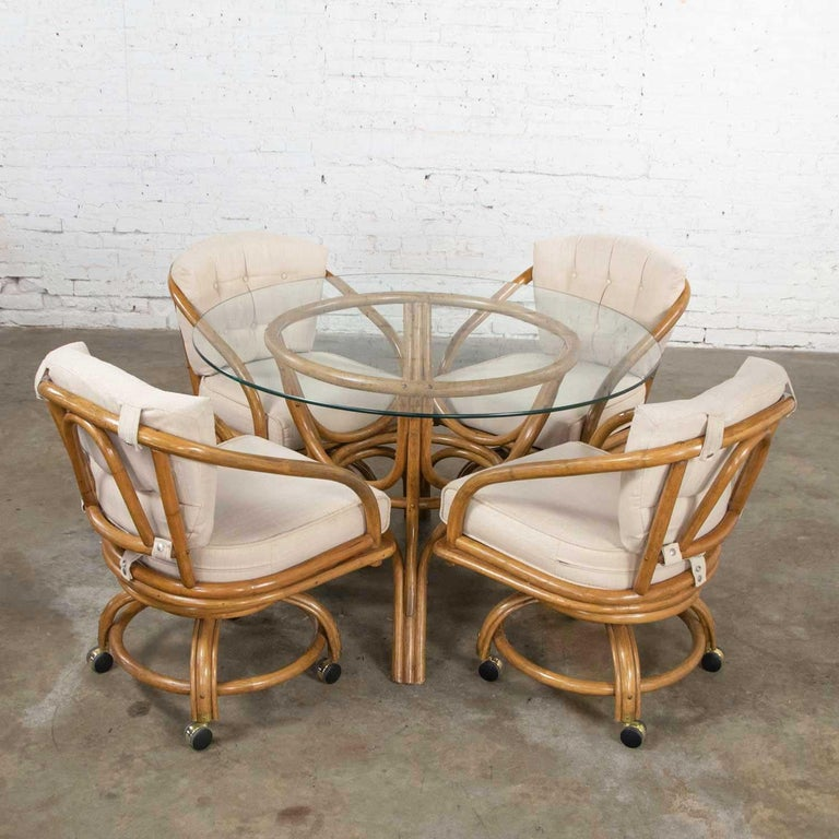 Organic Modern Vintage Rattan Game Table Set Round Glass Top Table and 4 Swivel Rolling Chairs For Sale
