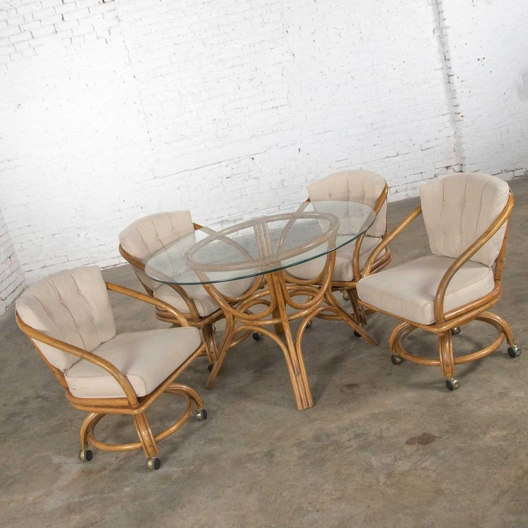 Unknown Vintage Rattan Game Table Set Round Glass Top Table and 4 Swivel Rolling Chairs For Sale