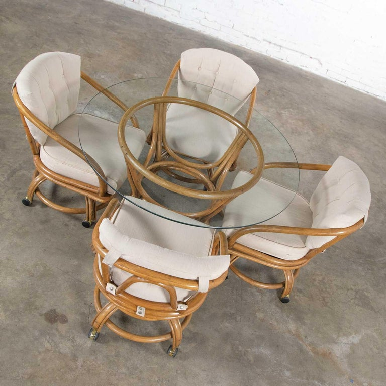 Vintage Rattan Game Table Set Round Glass Top Table and 4 Swivel Rolling Chairs In Good Condition For Sale In Topeka, KS