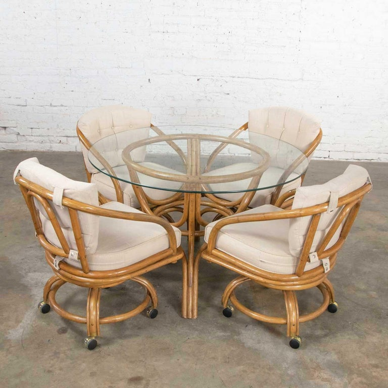 20th Century Vintage Rattan Game Table Set Round Glass Top Table and 4 Swivel Rolling Chairs For Sale