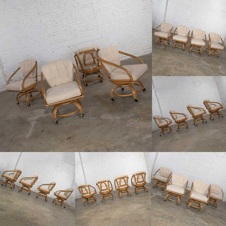 Fabric Vintage Rattan Game Table Set Round Glass Top Table and 4 Swivel Rolling Chairs For Sale
