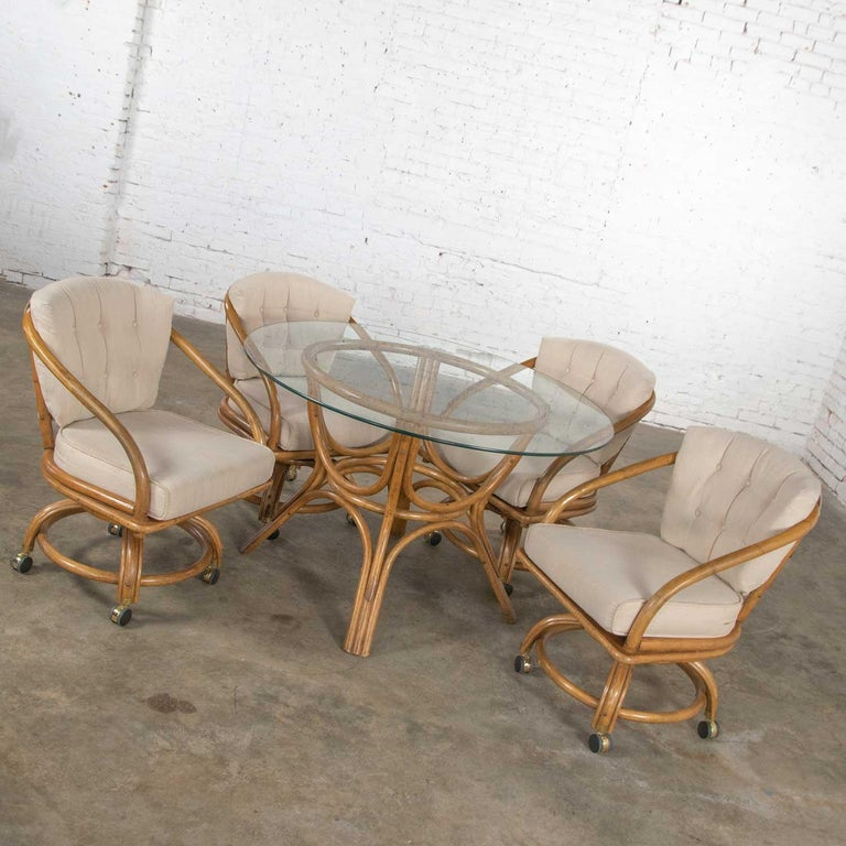 Vintage Rattan Game Table Set Round Glass Top Table and 4 Swivel Rolling Chairs For Sale 1