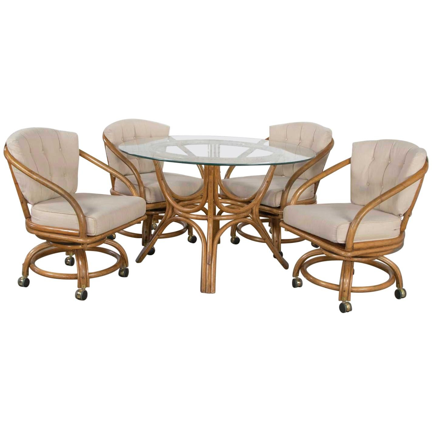 Vintage Rattan Game Table Set Round Glass Top Table and 4 Swivel Rolling Chairs