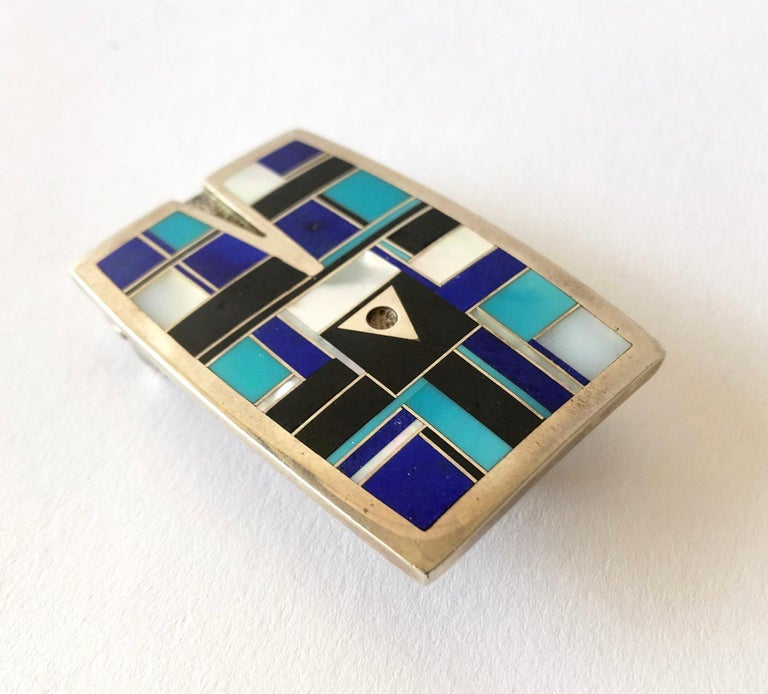Vintage inlaid lapis lazuli, mother of pearl and sleeping beauty turquoise belt buckle with arrow design within, created by Navajo jeweler Ray Tracey.  Buckle measures 2.25