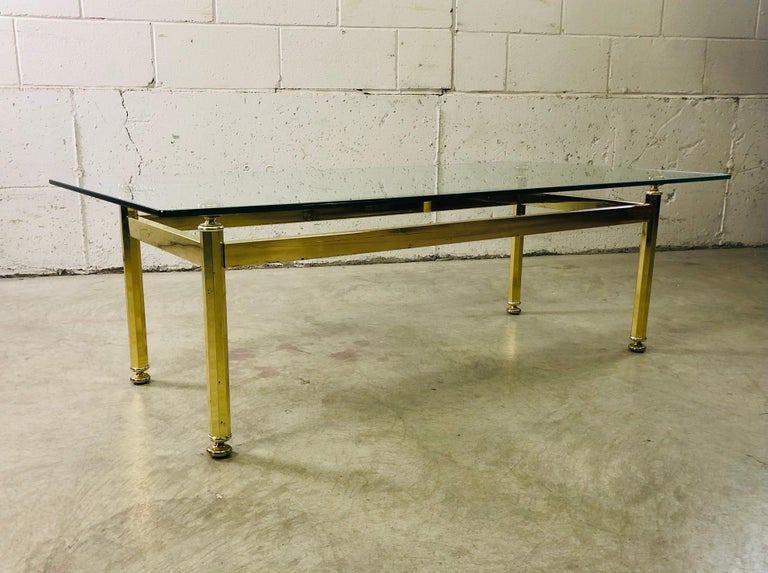 Vintage 1970s rectangular brass and glass top coffee table. Minimal wear to the glass and the table is sturdy. No marks.