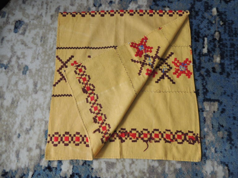 Vintage red and brown on yellow embroidered textile. Could be use as a table runner or topper and as well to make decorative pillows. Finished hem all around. Wool on cotton. Size: 20.5