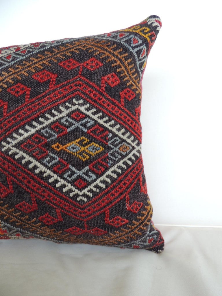 Vintage red and orange woven Kilim bolster decorative pillow with red linen backing. Decorative pillow handcrafted and designed in the USA. Closure by stitch (no zipper closure) with custom made pillow insert. Size: 15