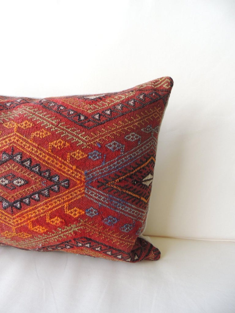 Vintage red and orange woven Kilim bolster decorative pillow with natural linen backing. Decorative pillow handcrafted and designed in the USA. Closure by stitch (no zipper closure) with custom made pillow insert. In shades of red, grey, black,