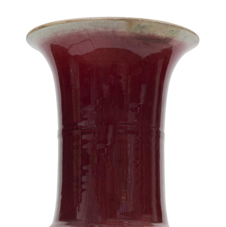 Vintage red ox blood Chinese vase in enameled ceramic with irregular trumpet mouth. China, Early 20th century.  Good conditions.  This object is shipped from Italy. Under existing legislation, any object in Italy created over 70 years ago by an