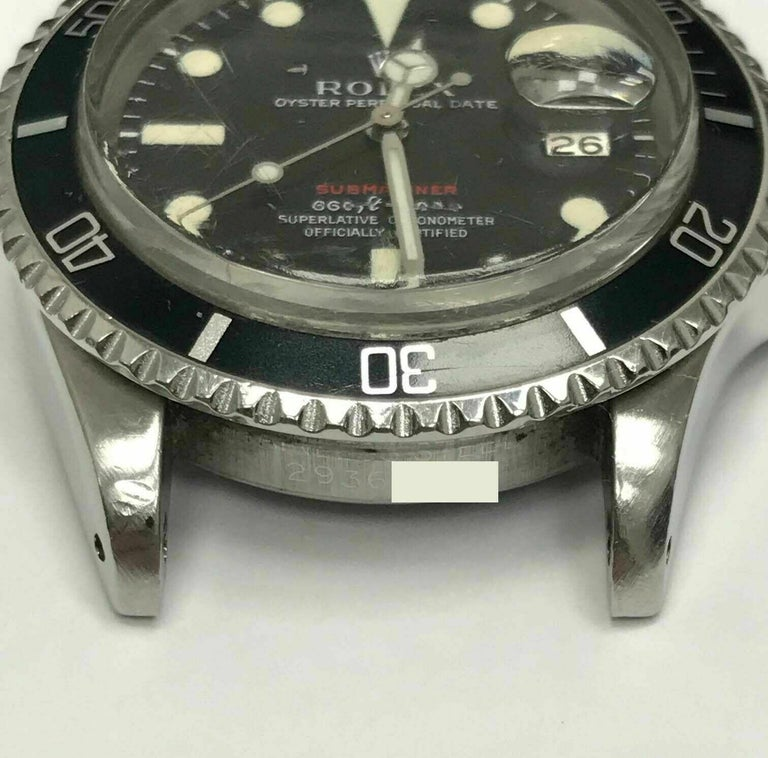 Style Number: 1680  Serial: 2936***  Year: 1970  Model: RED Letter Submariner  Case Material: Stainless Steel   Band: Stainless Steel   Bezel: Black  Dial: Black  Face: Acrylic   Case Size: 40mm  Includes:  -Rolex Box & Papers -Certified Appraisal