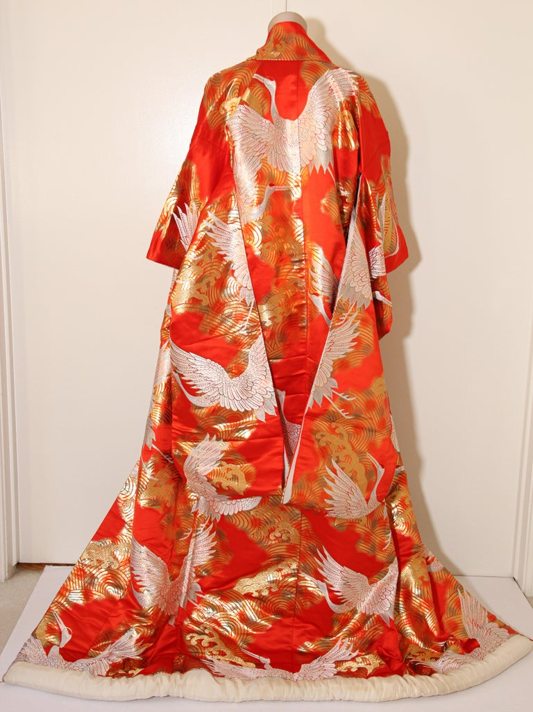 A vintage midcentury red color silk brocade collectable Japanese ceremonial wedding kimono.  One of a kind handcrafted. Fabulous museum quality ceremonial piece in pure silk with intricate detailed hand-embroidery throughout accented with gold