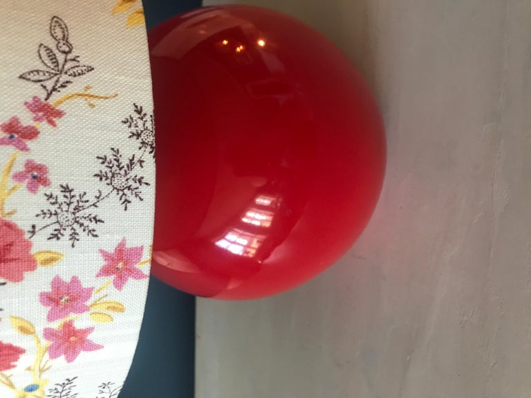 Beautiful red ceramic ball shaped table lamp.