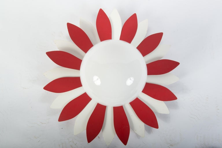 Unique vintage red and white metal flower petal ceiling light with milk glass globe. It could be adjusted to be wall mounted. Flower power!