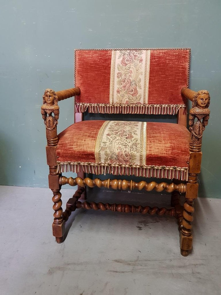 Vintage Renaissance style walnut armchair with carving in the armrest in the shape of 2 ladies and upholstered with a matching upholstery, it is also in good condition with light user marks all around. Originating from the second half of the 20th