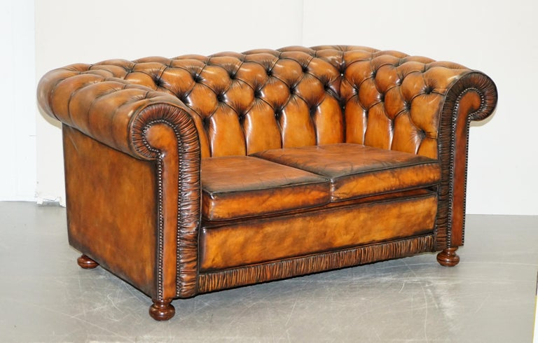 We are delighted to offer for sale this stunning vintage fully restored Chesterfield cigar brown leather library suite  A very rare find, I never come across original sets of three pieces from this era and especially not the fully buttoned sets.