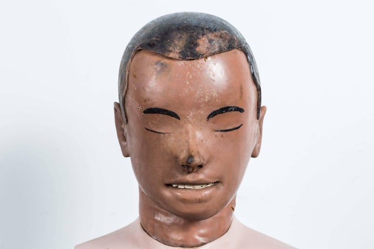 Vintage resuscitation man's head. Open mouth connected to tubes that would raise chest for CPR training. Resuscitation dummies were invented in the 1950s by Asmund Laerdal. Laerdal has a life-long devotion to innovative medical simulation and