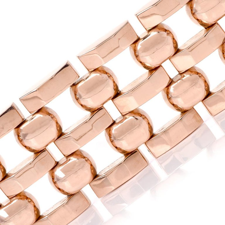 This vintage 1960s wide tank track link bracelet is crafted in 18Karat rose gold. Made up of 5 adjacent rows of tank and circular links. Weighing 73.4 grams, measures 7 ¼ inches around the wrist and 31.5mm wide. Secures with two sturdy clasp, bears