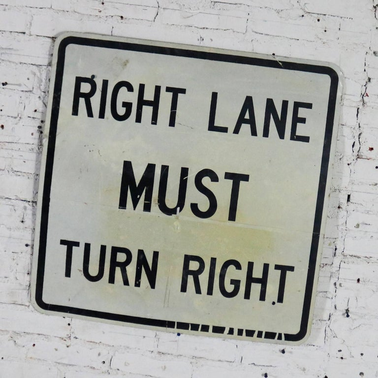 Awesome vintage steel Right Lane Must Turn Right traffic sign. This is a large sign and is in fabulous vintage condition with just the right amount of age and use patina. Please examine photos, circa 20th century.  Right lane must turn right, but