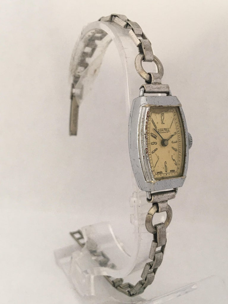 This beautiful vintage hand winding ladies watch is working and it is running well. Keeps a good time. Visible signs of ageing and wear with some scratches on the watch case and light scratches on the glass. The watch case is a bit tarnished as