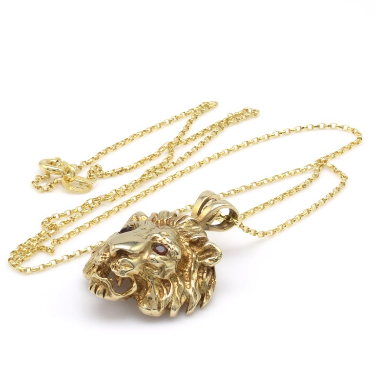 A superb solid yellow gold Lion pendant necklace with gemstone set eyes and complete with complimentary 18-inch lightweight gold belcher chain. Circa 1970s  - Lion weight: 5.3 grams - Chain weight: 1.1 grams - Hallmarks: Full assay marks to the