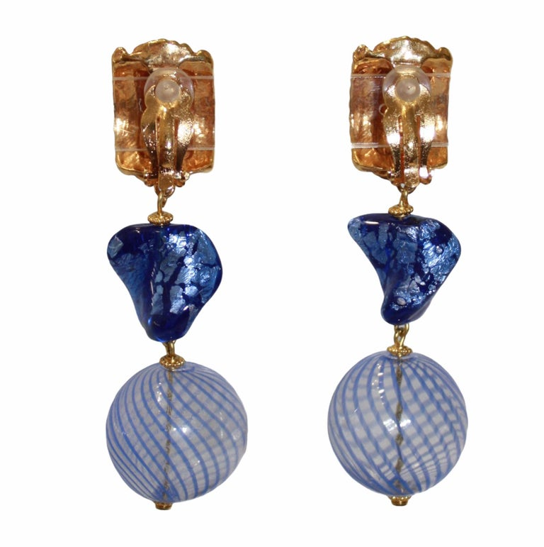 Circa 1990s beautiful and rare drops earrings featuring Murano glass work in majorelle blue, 24-carat dipped brass. Clip earrings with YSL signature in the back.
