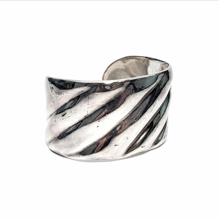 Sterling silver cuff bracelet by Mexican artisan, Roberto Ballesteros.  Beautifully crafted wide cuff bracelet with a ribbed design.  Measures approx 5 1/2