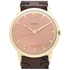 Vintage Rolex 14 Karat Yellow Gold Watch with a Salmon Dial, 1960s