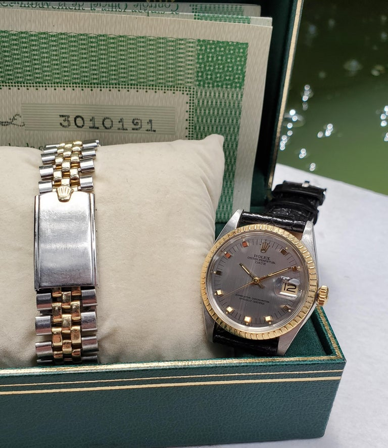 This 34mm Rolex Date model is sold on a new alligator strap. The original Rolex papers are included along with box and two tone jubilee link style rivet bracelet. The watch is from circa 1970. It is a 3.0 million serial number and model