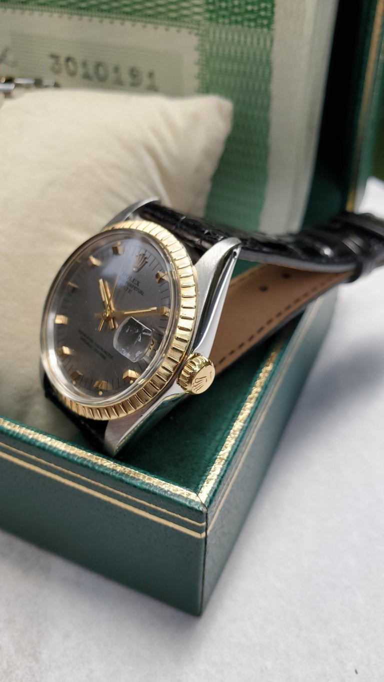 Vintage Rolex Date with Original Papers, Box and Stainless and 14 Karat Bracelet In Excellent Condition For Sale In New Orleans, LA