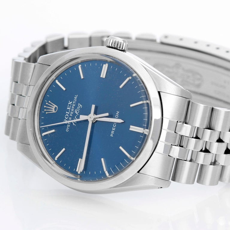 Vintage Rolex Air-King Men's Stainless Steel Oyster Perpetual Watch 5500 - Automatic winding, acrylic crystal. Stainless steel case with smooth bezel (34mm diameter). Blue dial with stick hour markers . Stainless steel Jubilee bracelet . Pre-owned