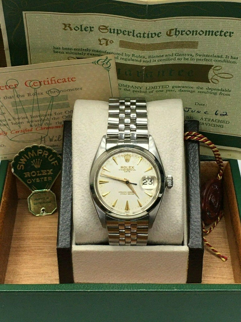 Style Number: 1500      Serial: 659***   Year: 1950     Model: Date     Case Material: Stainless Steel     Band: Stainless Steel     Bezel:  Stainless Steel     Dial: Silver     Face: Acrylic      Case Size: 34mm     Includes:   -Rolex Box & Papers