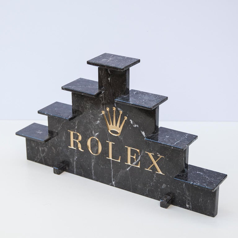Marble watch display marked with golden letters by Rolex, 1970s.