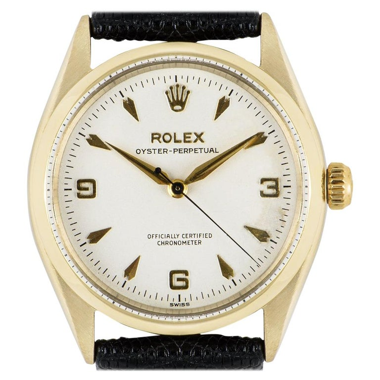 Vintage Rolex Oyster Perpetual 9k Yellow Gold 6564 Watch For Sale