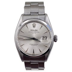 Vintage Rolex Oyster Perpetual Date 6534 Stainless Steel Roulette Date Window