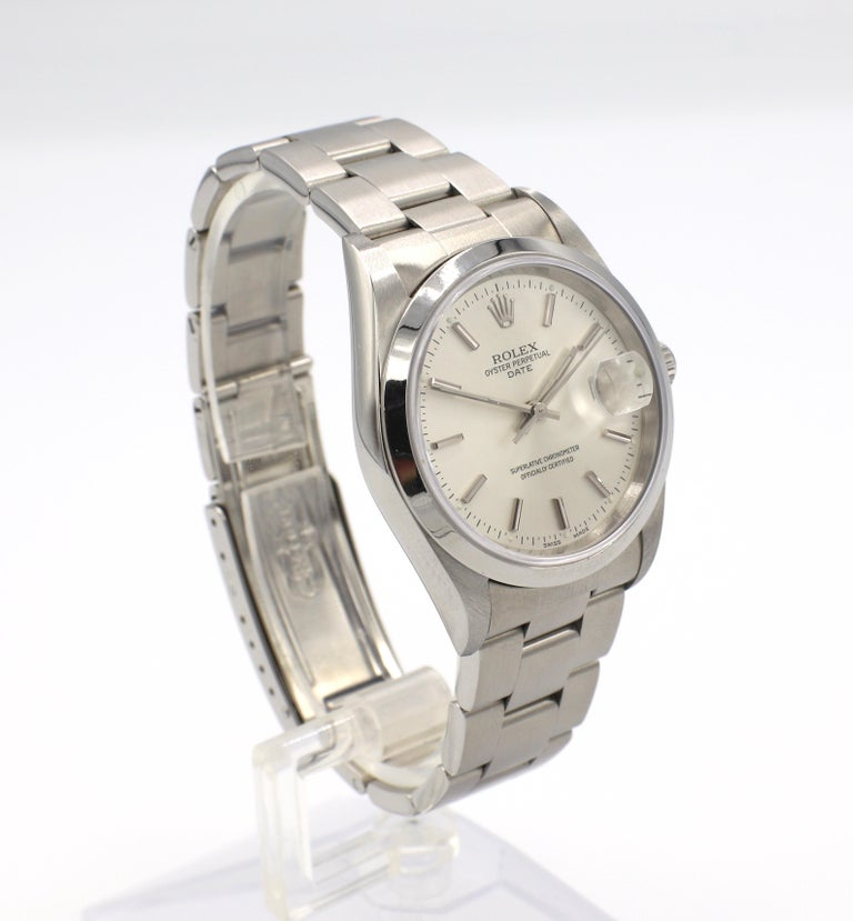 Vintage Rolex Oyster Perpetual Date Steel Watch Reference 15200 Box & Papers  Model: 15200 Serial: W815*** Metal: Stainless steel Case diameter: 34mm Dial: Silver Crystal: Sapphire Movement: Automatic  Original Box & Papers (papers dated 1997)