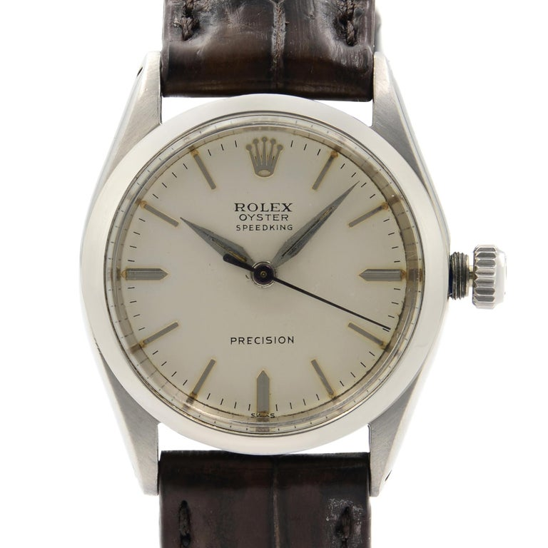 The vintage Rolex has some blemishes on the dial due to aging. Aftermarket Band but original Rolex Buckle.  Serial Number and Model Number is polished off.  Watch is From Circs 1950. Original Box and Papers are not included comes with a Chronostore