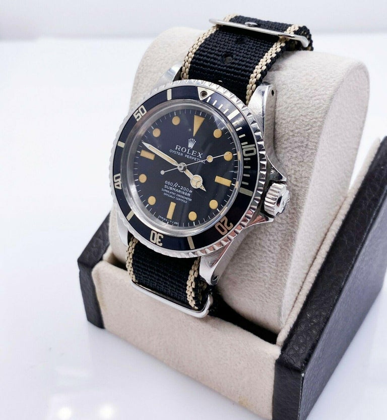 Style Number: 5512     Serial: 3443***   Year: 1973     Model: Submariner      Case Material: Stainless Steel     Band: Custom Nato Strap      Bezel:  Black      Dial: Matte Black Pumpkin Dial  4 Line      Face: Acrylic      Case Size: 40mm