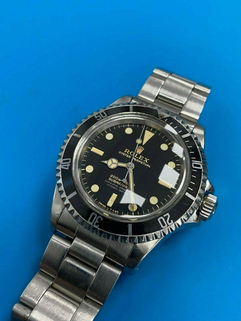 Style Number: 5512  Serial: 1098***  Year: 1964  Model: Submariner   Case Material: Stainless Steel  Band: Stainless Steel  Bezel:  Black  Dial: Black  Face: Acrylic Crystal  Case Size: 40mm  Includes:  -Elegant Watch Box -Certified Appraisal  -1