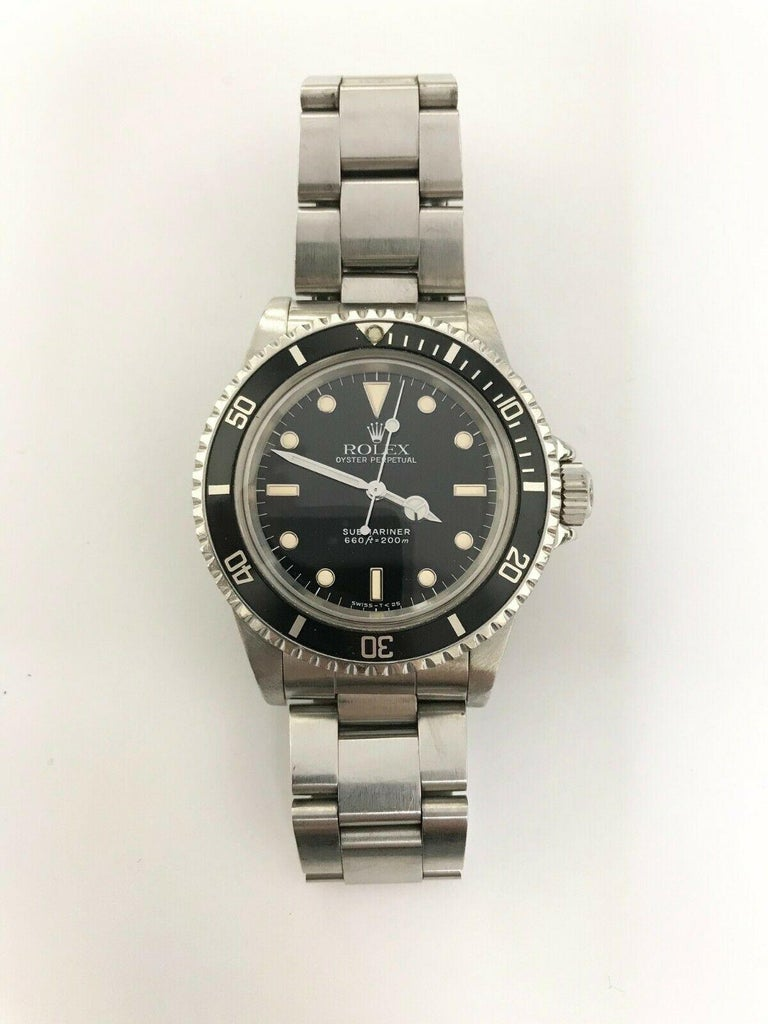 Style Number: 5513   Serial: L556***  Year: 1989   Model: Submariner   Case Material: Stainless Steel   Band: Stainless Steel   Bezel: Black    Dial: Black   Face: Acrylic    Case Size: 40mm   Includes:  -Rolex Box & Papers -Certified Appraisal  -1