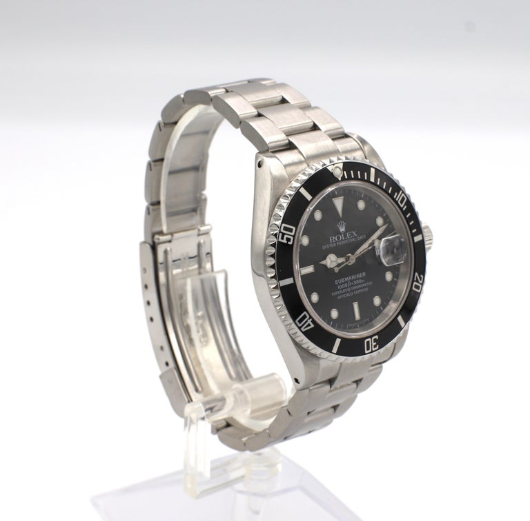 Rolex Submariner Stainless Steel Reference 16610  Model/Reference: 16610 Serial: T990*** (circa 1996) Metal: Stainless steel Dial: Black Case: 40mm Movement: Automatic  Condition: Very good, slight scratches to crystal and date magnifier.