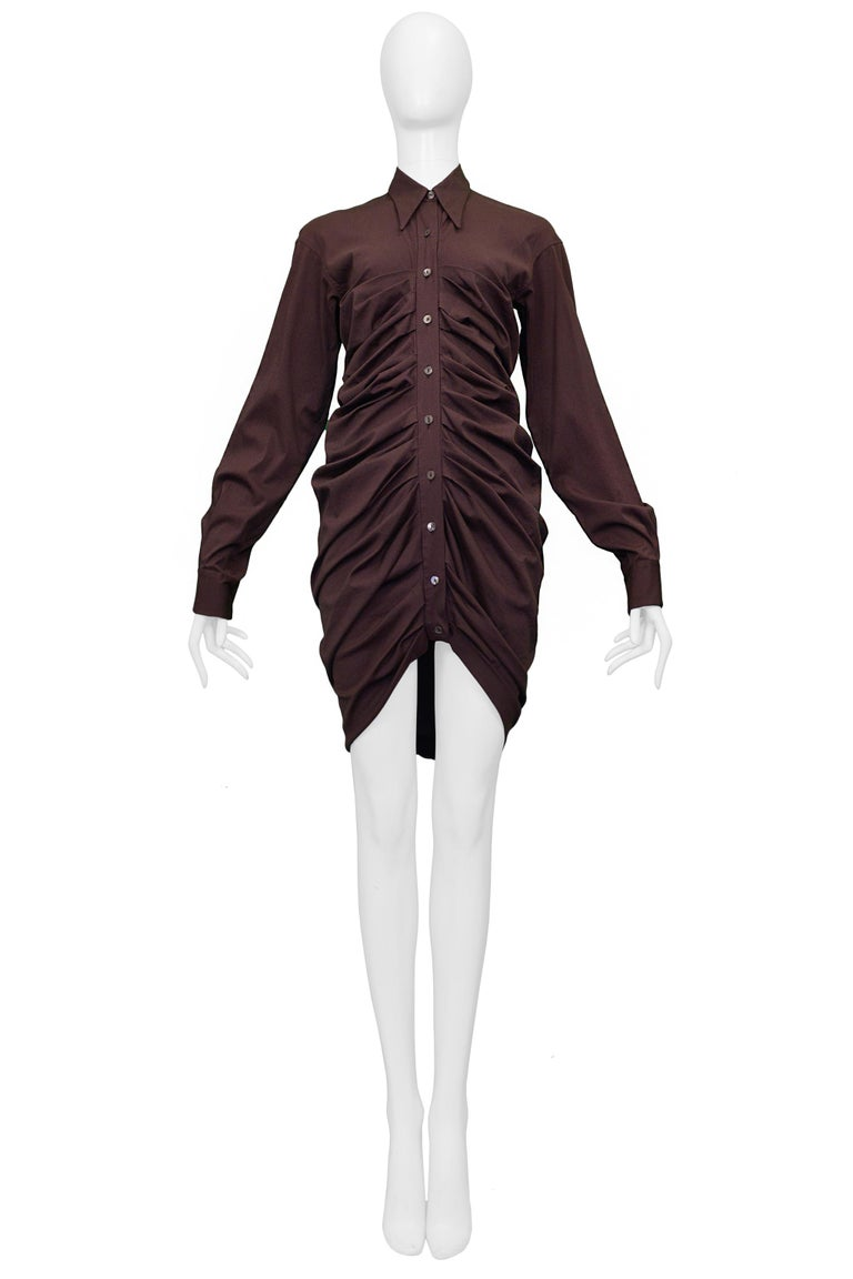 Resurrection Vintage is excited to present a vintage Romeo Gigli muted purple shirt dress featuring a pleated front, button placket, flat back, and a fitted body.   Romeo Gigli Size 38 Cotton Lycra Excellent Vintage Condition  Authenticity