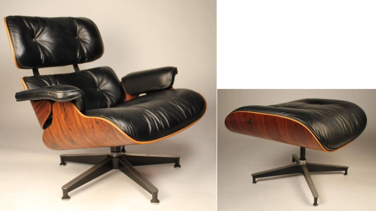 A very clean example of a vintage modern icon. Charles Eames 670 & 671 Lounge chair and ottoman produced by Herman Miller. All intact and all original. Beautiful striations in the Brazilian Rosewood graining. A great example and yes, they are as