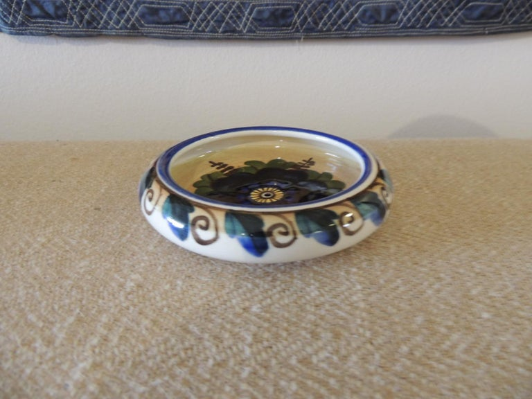 Vintage round blue and green decorative dish. Hand painted floral pattern. Crackle bone China. Markings 1329/1269 Size: 1.5
