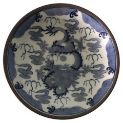 Vintage Round Blue and White Dragon Decorative Plate Encased in Brass