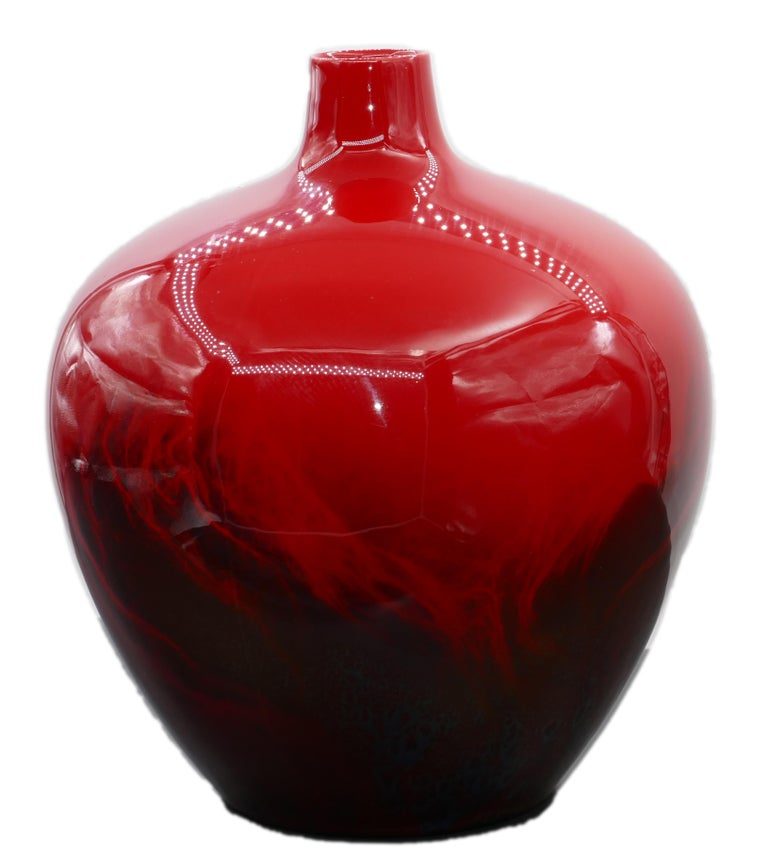 Royal Doulton vase is a beautiful black and red glass vase realized by the English firm Royal Doulton (London since 1815)  Our specimen is a flambe glazed vase, decorated with an abstract design.  On the bottom it is numbered 1616.  Very good