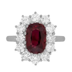 Vintage Ruby and Diamond Halo Cluster Ring, circa 1960s