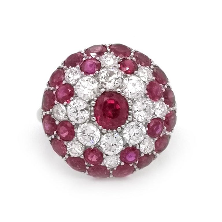 A vintage ruby and diamond cluster ring, with a low domed bombé cluster, set with early round brilliant-cut diamonds, with an estimated total diamond weight of 1.50ct and round-cut Burma rubies, with an estimated total ruby weight of 2.00ct, mounted