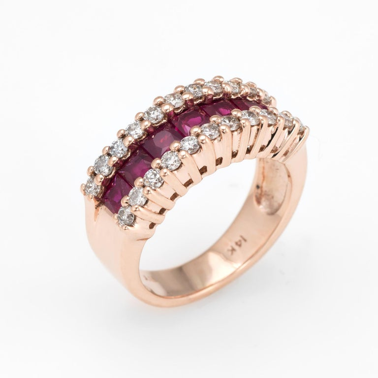 Elegant & finely detailed vintage ruby & diamond band, crafted in 14 karat rose gold.   7 estimated 0.15 carat cushion cut rubies total an estimated 1.05 carats. 22 estimated 0.02 carat round brilliant cut diamonds total an estimated 0.44  carats