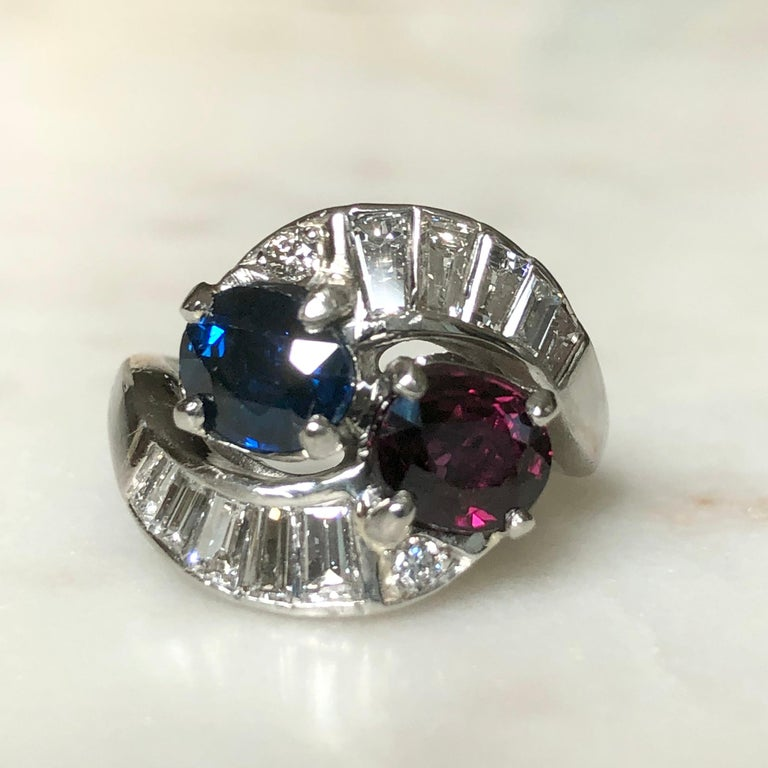 Oval Cut Vintage Ruby Sapphire Diamond Crossover Bypass Platinum Engagement Ring For Sale
